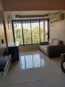 Gallery Cover Image of 595 Sq.ft 1 BHK Apartment for rent in Kanakia Park, Kandivali East for 23000