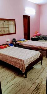 Bedroom Image of Raj Girls PG in Sector 10 DLF