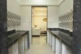 Gallery Cover Image of 730 Sq.ft 2 BHK Apartment for buy in Malad West for 14000000