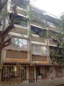 Gallery Cover Image of 585 Sq.ft 1 BHK Apartment for buy in Ujjwal Nandadeep CHS, Malad West for 9000000