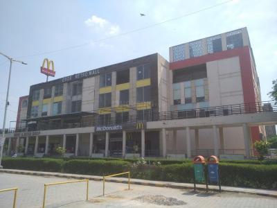 डीडीए ओम अपार्टमेंट में खरीदने के लिए 450.0 - 650.0 Sq.ft 1 BHK अपार्टमेंट शॉपिंग मॉल  की तस्वीर